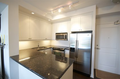Designer Kitchen Cabinetry With Stainless Steel Appliances, Granite Counter Tops, Undermount Sink, Valance Lighting & A Breakfast Bar.