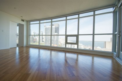 Bright Floor-To-Ceiling Windows With Laminate Flooring Facing C.N. Tower & Spectacular Unobstructed Lake Views.
