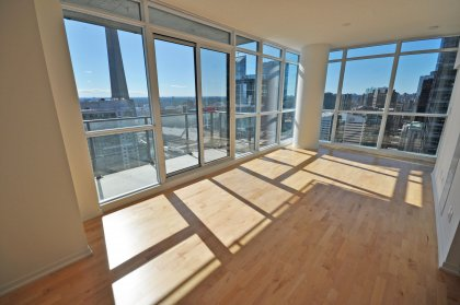 Open Concept Living & Dining Areas With Wrap Around Windows Facing Gorgeous C.N. Tower & Lake Views.