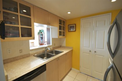 Updated Designer Kitchen Cabinetry With Stainless Steel Appliances & Pot Lighting.