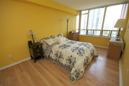 A Spacious Sized Master Bedroom With A 4-Piece Ensuite, Walk-In Closet & Laminate Flooring Facing The Park.