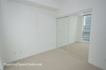 2nd Bedroom With Mirrored Closets Facing The Outdoor Roof Top Pool & C.N. Tower Views.