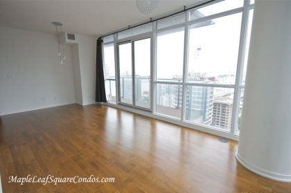 Open Concept Living & Dining Areas Featuring Wrap Around Windows & Hardwood Flooring Facing Gorgeous C.N. Tower & Lake Views.