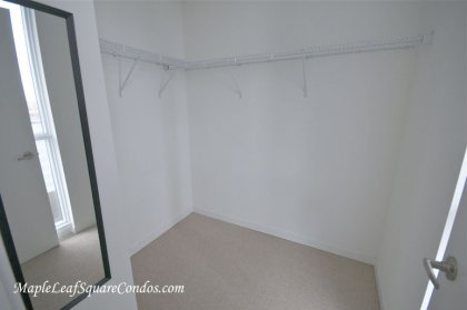 Master Bedroom Walk-In Closet With Window C.N. Tower & Lake Views.