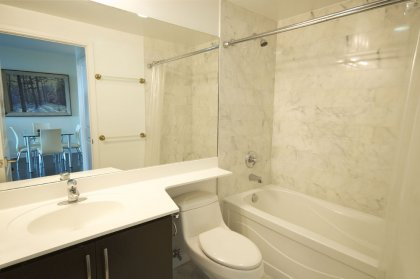 Main Bath With A 4-Piece, Upgraded Full Size Mirror & Marble Tiling.