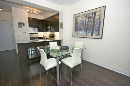 Bright 9Ft. Floor-To-Ceiling Windows With Gleaming Hardwood Flooring.