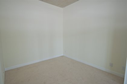Spacious Sized Master Bedroom With Sliding Dooors & A Closet.