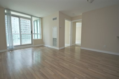 Open Concept Living & Dining Areas With Laminate Flooring.