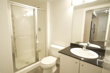 Main Bath With A Stand Up Shower & Granite Counter Top.