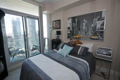 Spacious Sized Bedroom With Mirrored Closets & A Walk-Out Balcony Facing Stunning C.N. Tower & Lake Views.