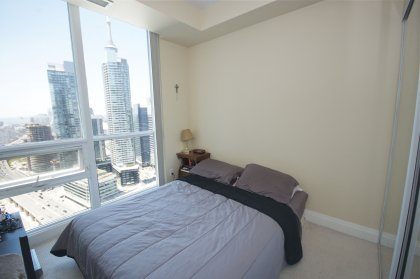 Spacious Sized 3rd Bedroom With Mirrored Closets Facing Stunning C.N. Tower & Lake Views.