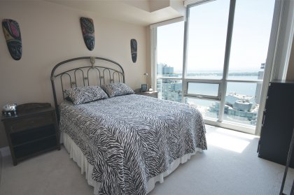 Spacious Sized Master Bedroom With A 5-Piece Ensuite & Walk-In Closet Overlooking Stunning Lake Views.