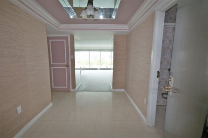 Suite Foyer With Marble Flooring, Crown Moulding & A Coffered Mirrored Ceiling.