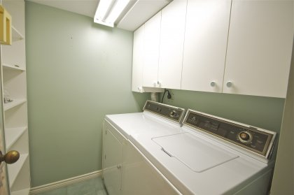 Separate Laundry Room With Ample Extra Storage Space.