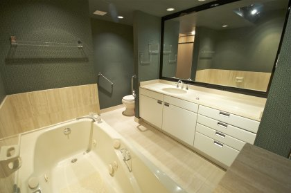 Master Bedroom Ensuite With Marble Throughout, Jacuzzi Soaker Tub & A Separate Stand Up Shower.