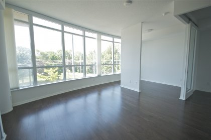 Open Concept Living / Dining Areas With Gleaming Hardwood Flooring Throughout Facing Park Views.