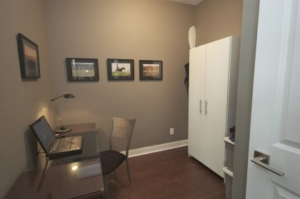 Spacious Sized Private Den Area With Double Doors & Hardwood Flooring.