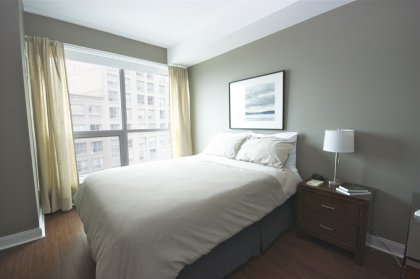 Spacious Sized Master Bedroom With Hardwood Flooring, Walk-In Closet & A 4-Piece Ensuite.