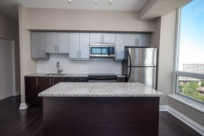 Designer Kitchen Cabinetry With Stainless Steel Appliances, Granite Counter Tops, Undermount Sink & A Centre Island.