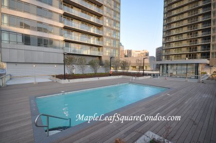 Outdoor Heated Pool With Tanning Deck Faces Spectacular CN Tower & Lake Views.