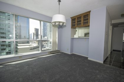 Open Concept Dining / Living Areas With New Carpeting Throughout Facing Gorgeous Unobstructed Lake Views.