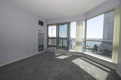 Open Concept Living / Dining Areas With New Carpeting Throughout Facing Gorgeous Unobstructed Lake Views.