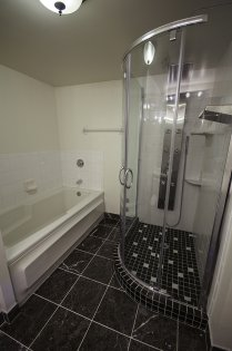 Master Ensuite With Full Sized Mirror, A Separate Tub & Unbelievable Spa Shower.