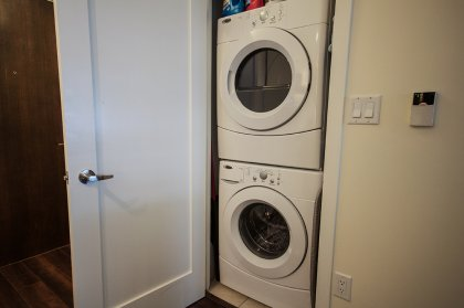 New Full Sized HE Stacked Washer & Dryer.