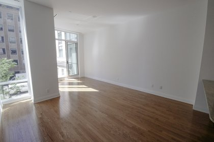 Bright 10Ft. Floor-To-Ceiling Windows With Gleaming Hardwood Flooring.