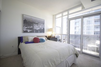 Master Bedroom With A Large Closet & Walk-Out Balcony Facing Stunning Lake & City Views.