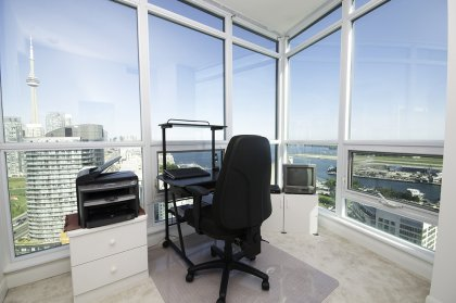 2nd Bedroom With Bright Floor-To-Ceiling Wrap-Around Windows Facing Spectacular Unobstructed C.N. Tower, Lake & Island Views.