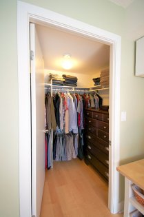 Spacious Walk-In Closet With Gleaming Hardwood Flooring Throughout.