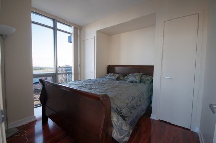 Spacious Sized Master Bedroom With Double Closets Onlooking Lake Views.