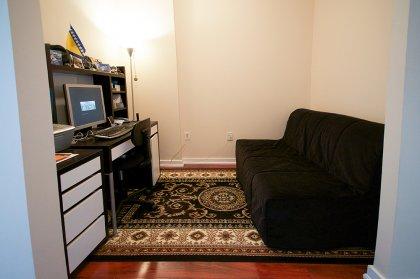 Separate Den Area With Laminate Flooring.