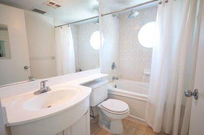 Main Bath With A 4-Piece & Full Sized Mirror.