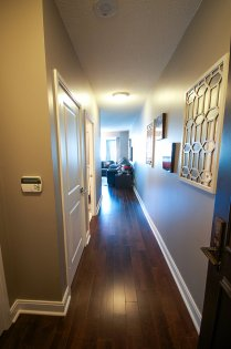 Suite Entrance With Gleaming Hardwood Flooring.