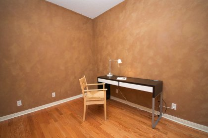 Large Private Den / Office Area With Gleaming Hardwood Flooring.