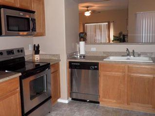 stainless smooth top range,microwave, dishwasher, refrigerator, garbage disposal, granite