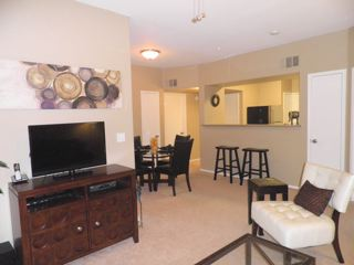 combination entertaining room, open to kitchen