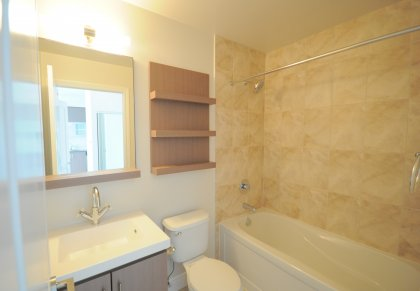 4-Piece Main Bath With Upgraded Cabinetry & Ceramic Tiles.
