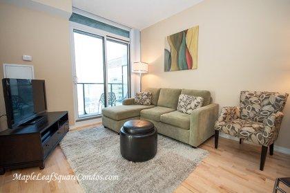 Open Concept Living Areas With Floor-To-Ceiling Windows & Hardwood Flooring.