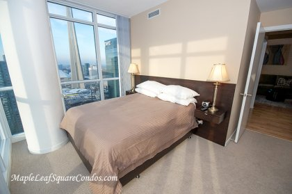 Master Bedroom With Wrap Around Windows Facing Gorgeous C.N. Tower & Lake Views. A 4-Piece Ensuite & Walk-In Closet.