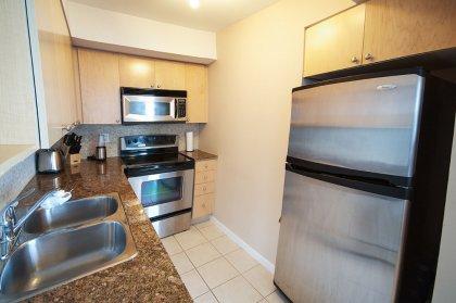 Designer Kitchen Cabinetry With Stainless Steel Appliances, Granite Counter Tops, Ceramic Backsplash & Flooring.