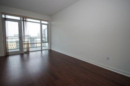 Bright Unobstructed Views With Floor-To-Ceiling Windows & Hardwood Flooring Throughout The Living Areas.