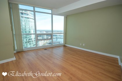 Bright Floor-To-Ceiling Windows With Hardwood Flooring Facing Stunning Unobstructed C.N. Tower & Lake Views.
