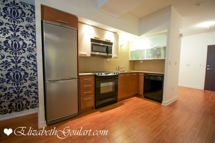 Features Designer Kitchen Cabinetry With Stainless Steel Appliances, Granite Counter Tops & Laminate Flooring.