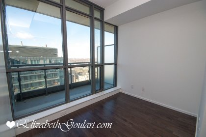 Separate Den Area With Hardwood Flooring Throughout.