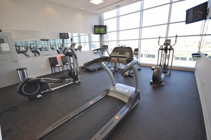 11th Floor Harbour Club Amenities. Cardio Room Overlooking Park Views.