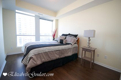 Spacious Sized Master Bedroom With A 3-Piece Ensuite, Gleaming Hardwood Flooring, A Walk-In Closet & Walk-Out Balcony Facing C.N. Tower Views.