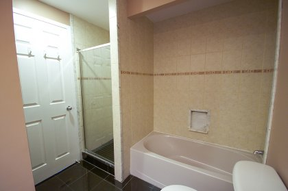 Main Bath With A Separate Soaker Tub & Stand Up Shower.